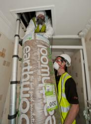 EvoEnergy installing loft insulation in preparation for the Green Deal