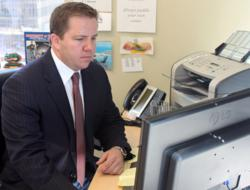 Austin personal injury attorney, Carl R. Barry of the Barry Law Group, working at his desk.