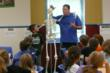 Valley Park Elementary teacher Mike Menley teaches students in suburban St. Louis about the skeleton.