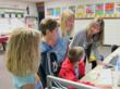 Students at West Bourbon Elementary in Uniontown, Kan. (left to right) Blair Rockhold, Luke Davis, Hayden Miller and Danielle Nading are guided by teacher Kendra Perry on HealthTeacher