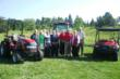 Case IH representatives pose with members of the DuPage County Forest Preserve District Board. Case IH entered into a lease agreement with the Forest Preserve District for the use of new Case IH equip