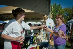 A guest samples a local creation at the annual Oakhurst Fall Festival