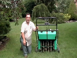 Lawn Aeration: Mike Taraborrelli, Lawn Care Manager at Giroud Tree and Lawn, uses an aeration machine to break through compacted soil and dense thatch allowing air and nutrients to reach the grass roots to stimulate root growth and build a healthy thick l