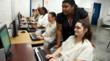 Inmates learn new software applications in a computer lab course at CCA Dawson State Jail, Dallas, Texas