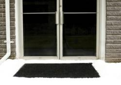 Martinson-Nicholls new Industrial Snow-Melting Entrance Mats are electrically heated carpet mats designed to prevent snow and ice accumulation around building entryways - photo
