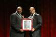 Daryl Parks, president of the National Bar Association, presents attorney Greg Francis with the Vince Monroe Townsend, Jr. Legends award at the organization's 87th annual convention in Las Vegas.