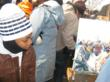 Attendee watches as Purchin paints at 2009 Presidential Inauguration.