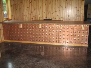 Chelsea decorative metal company introduces pressed tin for Bar front ideas