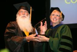 CalSouthern President, Dr. Caroll Ryan presents John Galaska, PsyD, with the President's Award for Doctoral Project Excellence