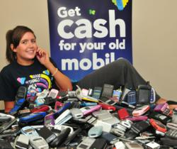 Girl with piles of phones helps break the Guinness world record for the most phones recycled