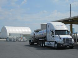 Brenntag North America Facility displaying a bulk DEF tank farm, DEF stainless steel tanker and DEF totes.