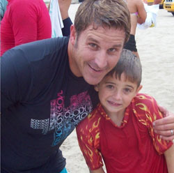 Phil Ambrose, who paddles for the Ocean of Hope, with son Caden..