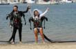 Newly married couple Mr. and Mrs. Grant Engler celebrate together after the world's first-ever water jetpack wedding ceremony hosted by ZOZI on Thursday, August 23, 2012 in Newport Beach, CA.