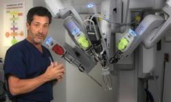 A Doctor in front of the da Vinci robot filming a medical segment
