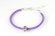 TNT/LLS Bead and Purple Bracelet Combo: A purple cord bracelet and sterling silver TNT/LLS Bead us a super way to show your commitment to the Team in Training® program and the LLS.