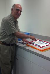 Dr. Matthew Mashikian, founder of IMCORP, cuts the cake
