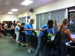 JHM volunteers prepare back packs for homeless Orlando students