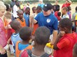 Kicking Coach Tom Feely Surrounded by Young Haitian Athletes
