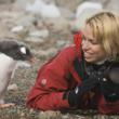 Photographer Jeanine Lovett with Gentoo Penguin in Antacrtica.