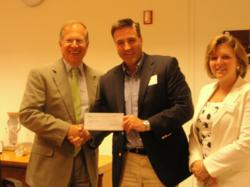 Stan Litow (left), VP at IBM, presents gift to David Gerstner and Debbie Siciliano, LRA