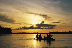 Dugout canoe at sunset on the Amazon River
