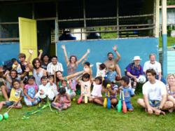 Another beautiful day in paradise with Give & Surf's preschoolers, some local circus talent, and volunteers.