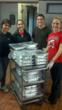 Members of the University of Maryland Food Recovery Network recover food that would otherwise have been thrown away from a dining hall on campus.