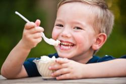 Boy smilng over fresh ice cream