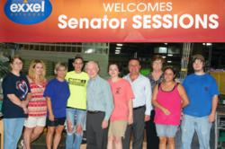 Sen. Sessions with a group of Exxel Outdoors factory workers, CEO Harry Kazazian and VP Barbara Garrison
