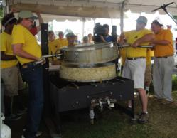 The Big Reveal - Handy employee's Chris and Jim remove the pan off the 300lb. cake. Photo by Brenda Bowen
