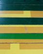 Sourced from Dartmouth College, where athletic teams are known as Big Green, this particular batch of reclaimed gym flooring plays homage the school's colors with numerous green boards and yellow accents.