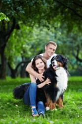 A dog who has pet insurance poses with family