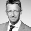 Black and white head and shoulders shot of Claes Svensson, Chief Executive Officer, Redeem Holdings Limited