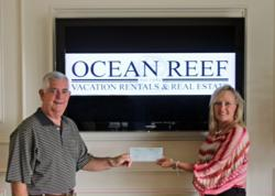 Ocean Reef Resorts CEO and President Tim Taylor has presented Kathy Eller, of the Destin Seafood Festival, a sponsorship check in support of the popular annual community event.