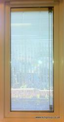 Integrated blind between the panes of glass