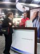 SG recruiter speaks with prospective physician at 2011 ACEP conference.