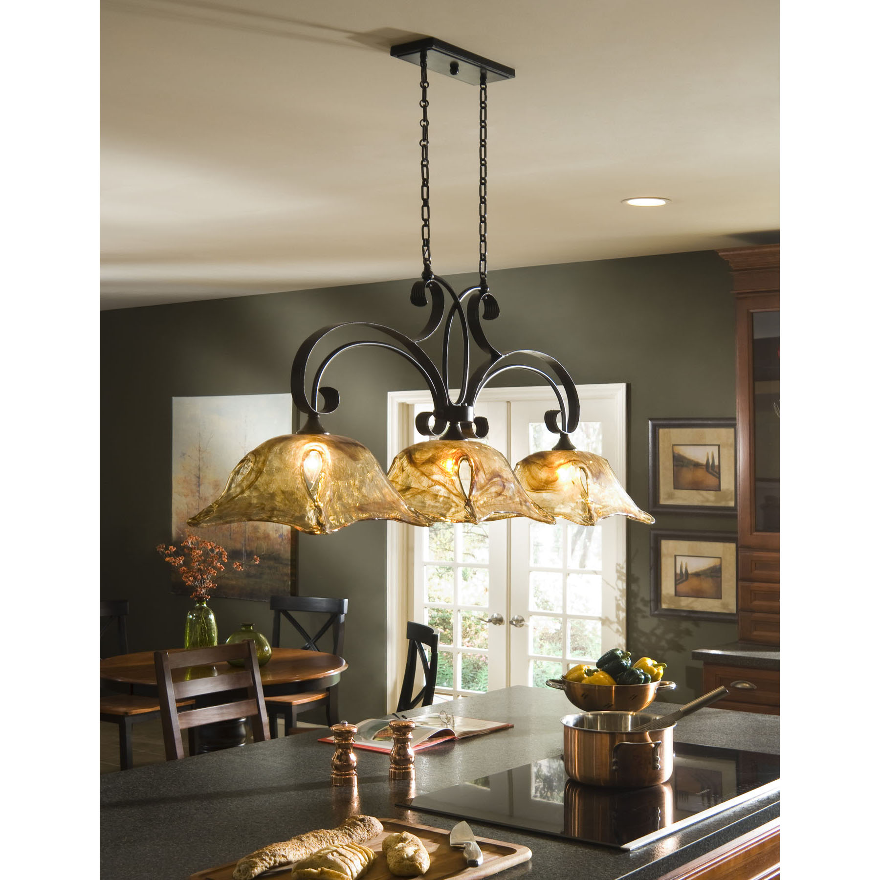 A tip sheet on how the right lighting can make the kitchen for Over island light fixtures