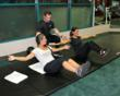 HealthQuest Certified Personal Trainer, Brandon Founds, works with two female clients on core exercises.