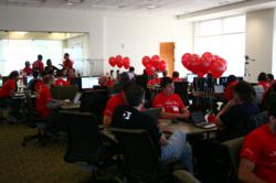 Teams work on rapid app development during a hackathon at Dominion Enterprises