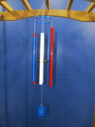 tuned wind chimes with red white and blue tubes.
