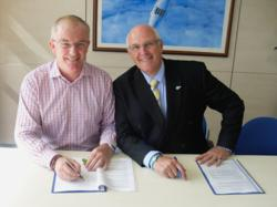 Bluebird Care Managing Director, Paul Tarsey signing the contract with Stephen Flanagan, Managing Director of Bupa Home Healthcare.