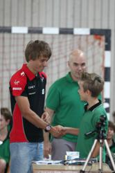Marussia F1 Team driver Charles Pic with GESS student winner