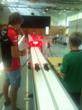 Charles Pic competes with a GESS student at the model race track