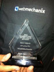 WebMechanix Co-Founder, Arsham Mirshah, showcasing the AMA Marketing Excellence Award for SEO Merit.