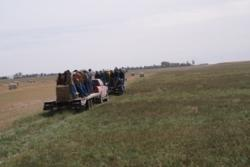 Tour participants learn about the Kopriva family's rotational grazing techniozques.