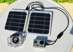 The sCarger-5 solar charger charging a GoPro camera