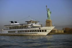 The Duchess, owned by World Yacht at Pier 81, sails near the Statue of Liberty