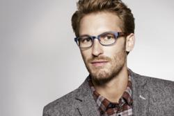 Model wearing Warby Parker Quincy Eyeglasses in Brushed Opal