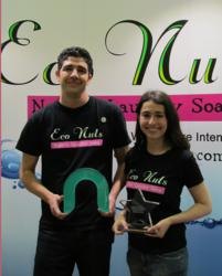 Eco Nuts co-founders Scott Shields and Mona Weiss hold their awards