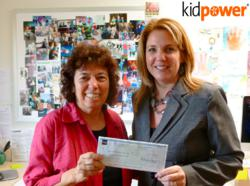 Irene van der Zande, Kidpower Founder and Executive Director, receives a grant check from Wells Fargo AVP/Manager Michele Bassi.
